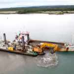 Split hopper dredgers